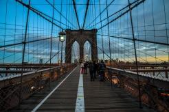 New York/USA - 1/3/18 - People crossing the bridge at Sunset